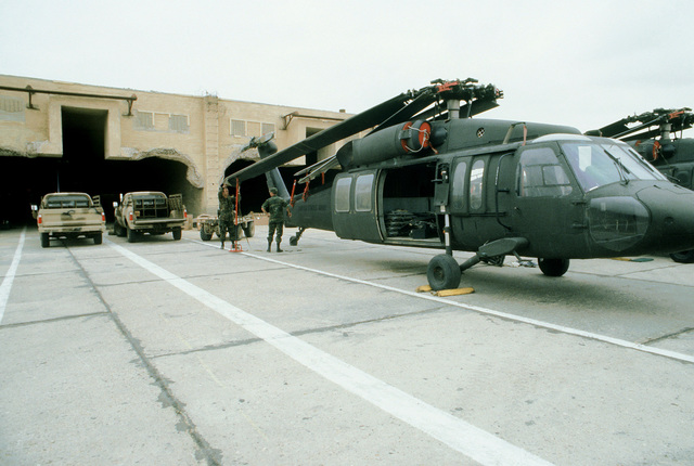 Air Force maintenance crews prepare a UH-60A Black Hawk helicopter for shipment aboard a C-5 Galaxy aircraft to Ft. Campbell, Kentucky, at the conclusion of exercise Bright Star '80