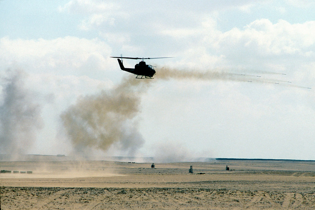 AN AH-1 Cobra gunship helicopter takes part in an aerial firepower demonstration, attended by officials from the Egyptian government, during exercise Bright Star '80