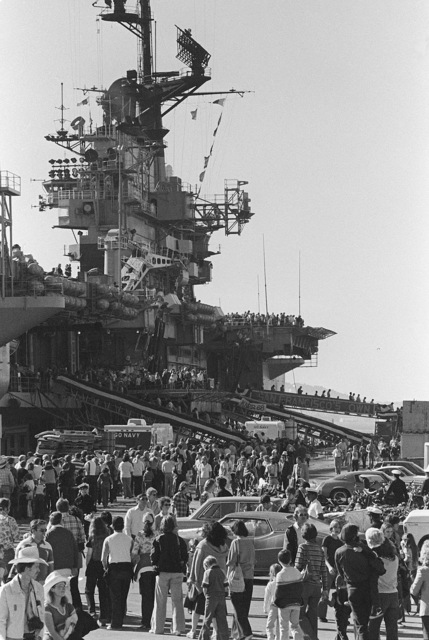 An open house aboard the aircraft carrier USS CORAL SEA (CV 43) draws a crowd