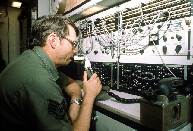 SSGT Carl E. Carter, 226th Combat Communications Squadron, changes the frequency on the TSC-60 radio control head and patch panel during exercise Bright Star '80