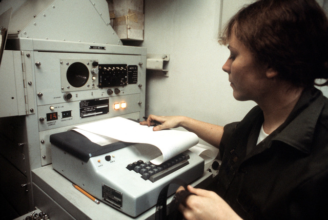 SSGT Denise L. Brown, 226th Combat Communications Squadron, monitors the weather control teletype during exercise Bright Star '80