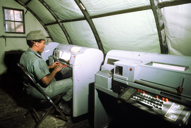 SSGT Geneva P. Brown, 232nd Combat Communications Squadron, Montgomery, Alabama, types a message for transmission on a teletype machine during exercise Bright Star '80