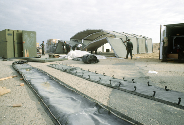 The 4449th Mobility Support Squadron assembles the vehicle maintenance shelter during exercise BRIGHT STAR '80