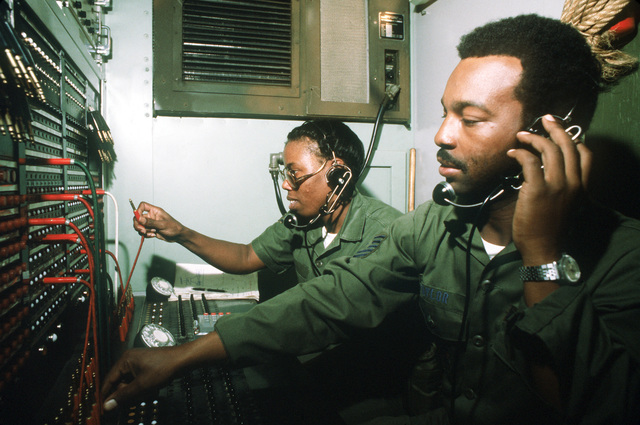 TSGT Julius C. Taylor Jr. and AMN Lillian M. Hill operate the central telephone switchboard during exercise Bright Star '80