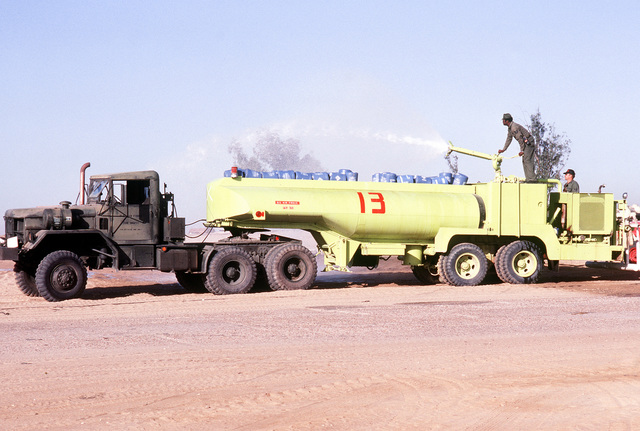 TSGT Thomas P. Ward, 31st Civil Engineering Squadron fire department, Homestead Air Force Base, Fla., operates the pump on the F-7 runway foamer while TSGT James W. Palmer, 23rd Civil Engineering Squadron, England Air Force Base, La. operates the turret during exercise BRIGHT STAR '80