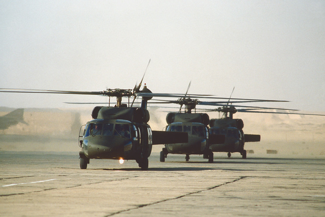 UH-60 Black Hawk helicopters are lined up waiting to take Egyptian troops aboard for joint familiarization flights during exercise Bright Star '80
