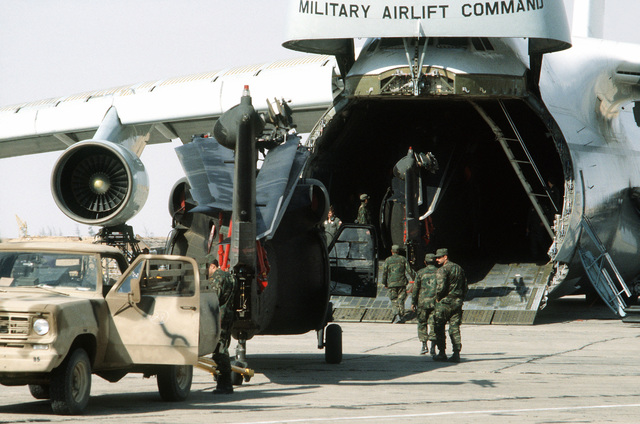 UH-60 Black Hawk helicopters are loaded aboard a C-5 Galaxy aircraft for the trip home after the conclusion of exercise Bright Star '80