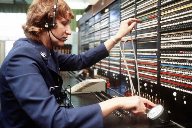 AB Betty S. Taylor, base operator, at work in the Switchboard Center of the 1974th Communications Group, Air Force Communications Command