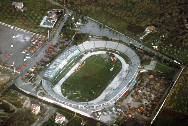 AN aerial view of the soccer stadium, used as a landing site for helicopters bringing in relief supplies to victims of a major earthquake. Tents, used for temporary housing, surround the stadium