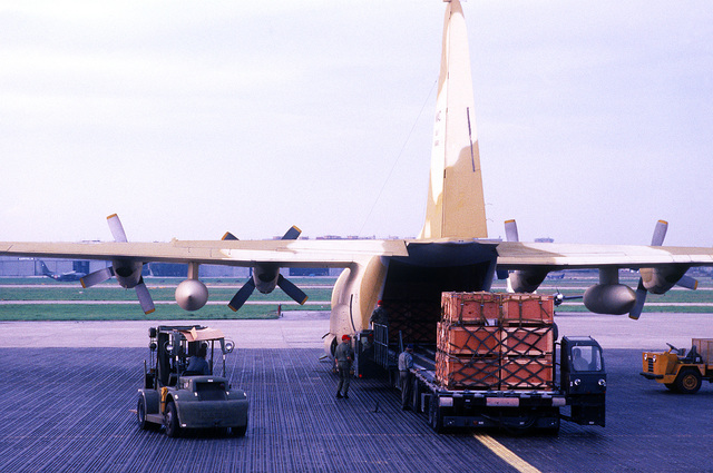Pallets of Army tents are offloaded from an Air Force C-130 Hercules aircraft at Capodichino Airport. The tents will be set up to provide temporary housing for people homeless as a result of a major earthquake