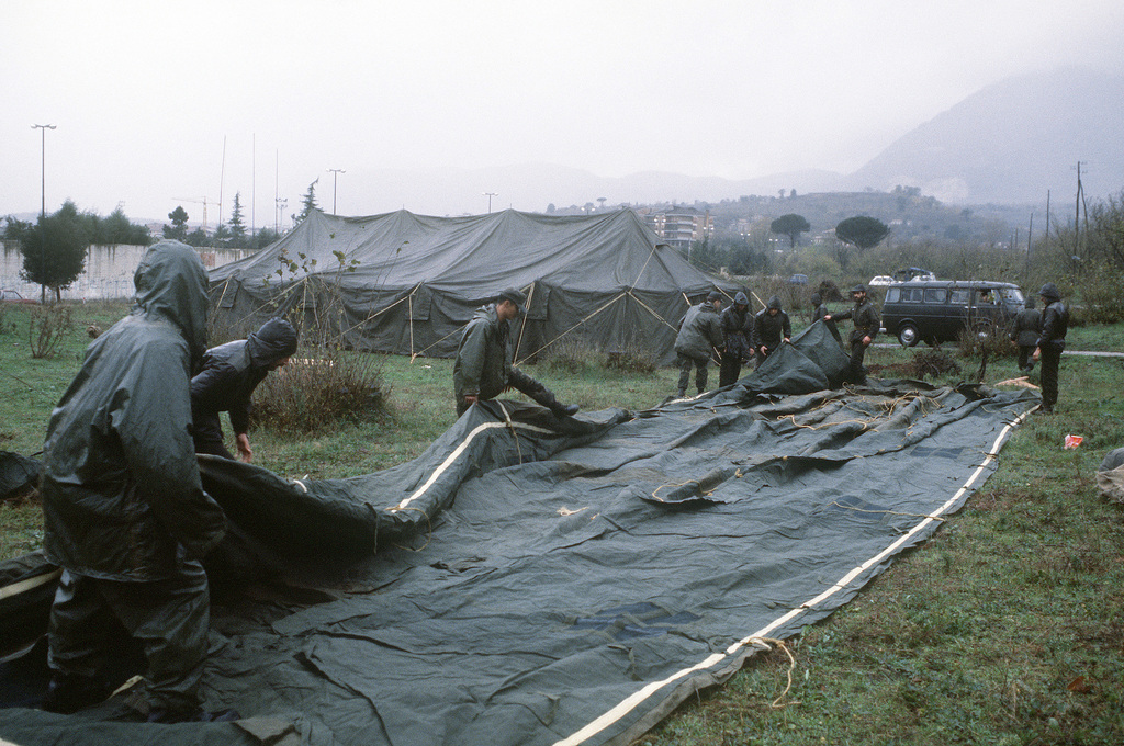 Tents are put up by Army personnel from Company A, 1ST Battalion of the 509th Infantry. The tents will provide temporary shelter for homeless victims of a major earthquake