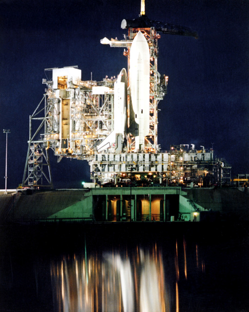 A night view of the Space Transportation System (STS) shuttle Columbia on Launch Pad 39. The shuttle is undergoing preparations prior to its maiden flight