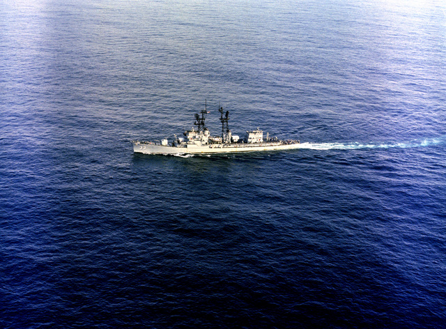 An aerial port beam view of the guided missile destroyer USS PARSONS (DDG 33) underway
