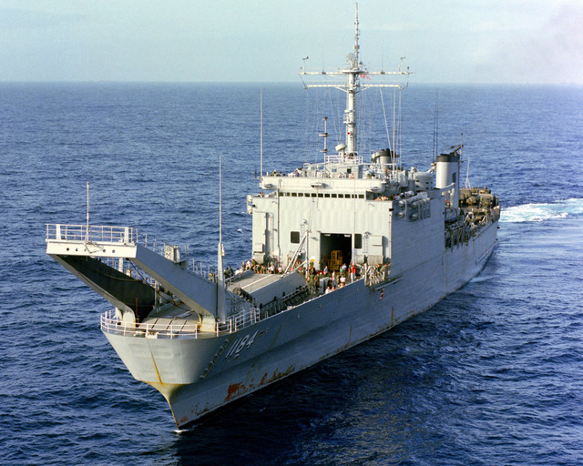 An aerial port bow view of the tank landing ship USS FREDERICK (LST 1184) underway