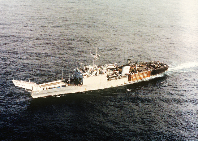 An aerial port bow view of the tank landing ship USS RACINE (LST-1191) underway