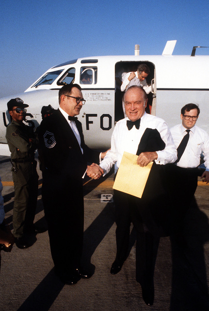 CHIEF MASTER SGT. Tom Feeney greets entertainer Bob Hope as he arrives for the ceremony in which he will be inducted into the Military Airlift Command Order of the Sword. Exact Date Shot Unknown