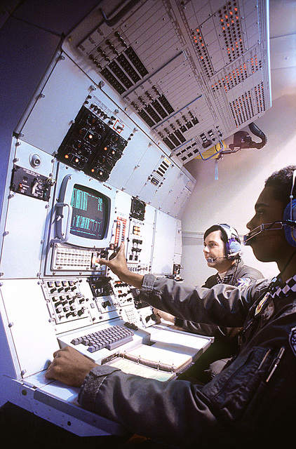 E-3A airborne warning and control system aircraft crew members operate a control panel, during flight. The flight mission is part of a joint training exercise with elements of the NATO air-defense system in central Europe