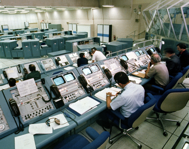 Personnel at the Space Transportation System (STS) Launch Control Center prepare for the launch of the shuttle Columbia