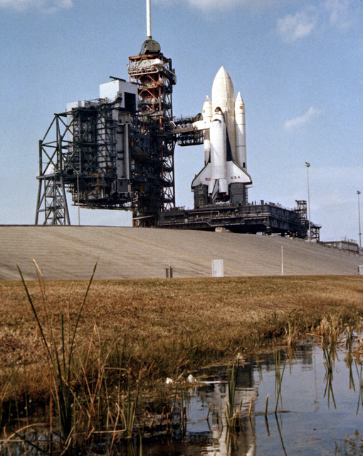 The Space Transportation System (STS) shuttle Columbia on Launch Pad 39. The shuttle is undergoing preparations prior to its maiden flight