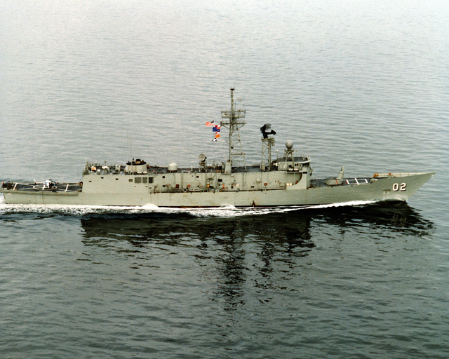 An aerial starboard beam view of the Australian frigate CANBERRA (F-02) as Todd Pacific Shipyards Corporation conducts sea trials