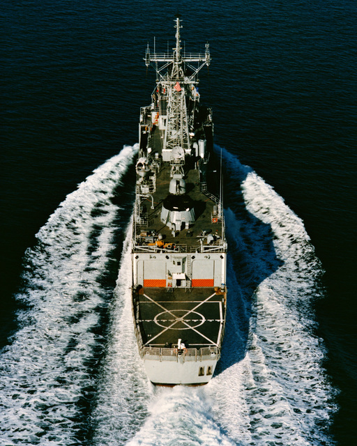 An aerial stern view of the Australian frigate CANBERRA (F-02) as Todd Pacific Shipyards Corporation conducts sea trials