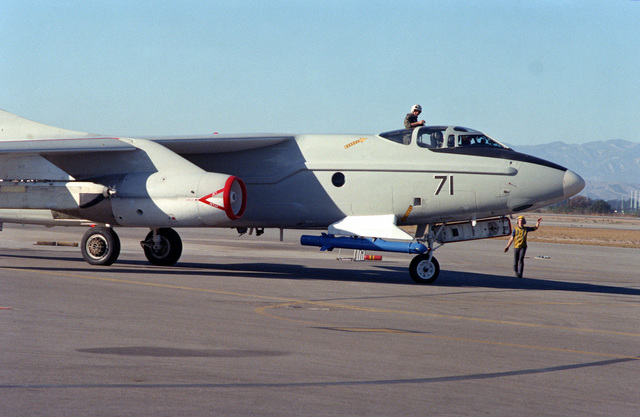 A preflight check is performed on a parked A-3 Skywarrior aircraft, equipped with electronic countermeasures systems, at Pacific Missile Test Center