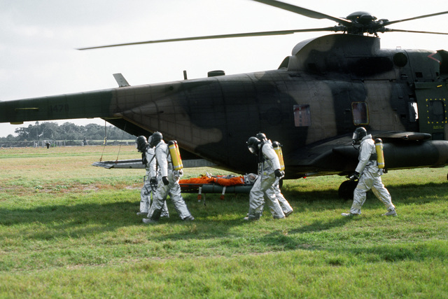 Pararescuemen from the 38th Aerospace Rescue and Recovery Squadron carry an astronaut mannequin on a stretcher to a rescue exercise. The exercise is one of several planned to optimize rescue and recovery operations for the space shuttle Columbia