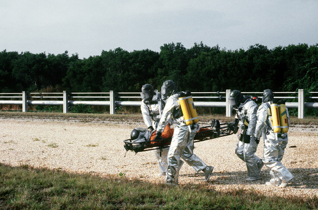 Pararescuemen from the 38th Aerospace Rescue and Recovery Squadron carry an astronaut mannequin during a space shuttle rescue exercise. The exercise is one of several planned to optimize rescue and recovery operations for the space shuttle Columbia