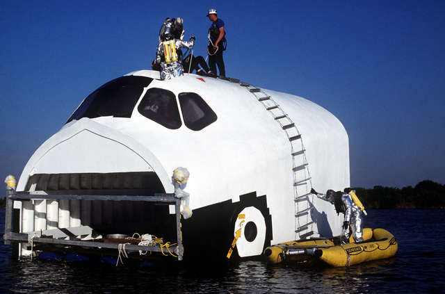 Pararescuemen from the 38th Aerospace Rescue and Recovery Squadron deploy rafts during a space shuttle rescue exercise with the mockup Columbia. The exercise is one of several planned to optimize rescue and recovery operations for the real Columbia