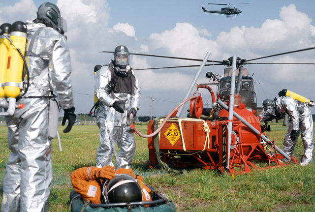 Pararescuemen from the 38th Aerospace Rescue and Recovery Squadron use decontamination equipment to spray down an astronaut mannequin during a space shuttle rescue exercise. The exercise is one of several planned to optimize rescue and recovery operations for the space shuttle Columbia