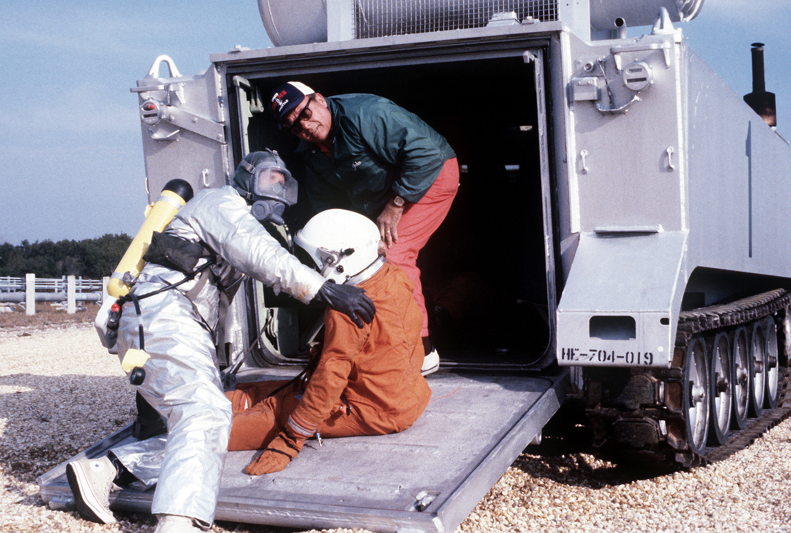 Two pararescuemen remove an astronaut mannequin from the XM-1 astronaut recovery tank and place it on a stretcher during a space shuttle rescue exercise. The exercise is one of several planned to optimize rescue and recovery operations for the space shuttle Columbia