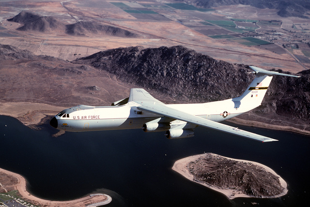 AN air-to-air left side view of a C-141B Starlifter aircraft