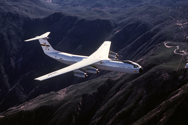 AN air-to-air right front view of a C-141B Starlifter aircraft