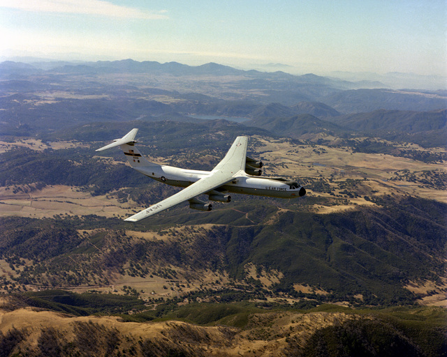 An air-to-air right side view of a C-141 Starlifter aircraft over Norton Air Force Base