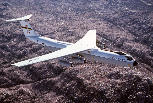 AN air-to-air right side view of a C-141B Starlifter aircraft