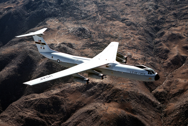 AN air-to-air right side view of a C-141B Starlifter aircraft over Norton Air Force Base
