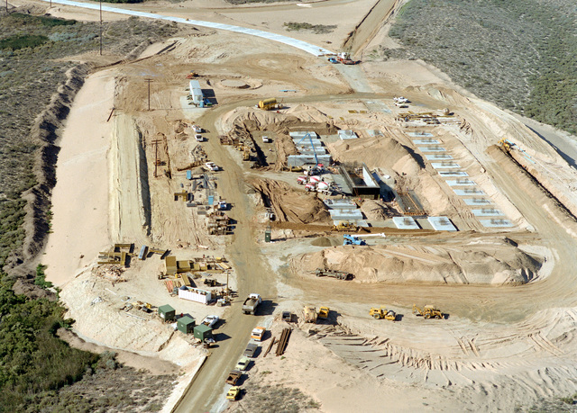 An aerial view of the Missile X (MX) advanced intercontinental ballistic missile mechanical maintenance facility construction progress, looking southwest