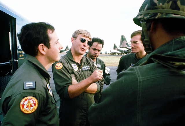 Members of the 21st Tactical Airlift Squadron give the Philippine army jumpmaster a preflight briefing during a 374th Tactical Airlift Wing exercise