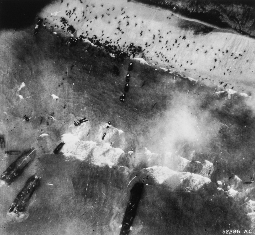 Aerial Photograph of the Landing Operation on the French Coast Showing Three LSTs Stuck in Shallow Water off Shore