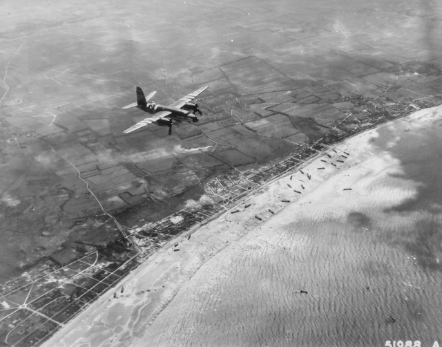 Photograph of a B-26 Martin Marauder Giving Cover to the Landing Craft on the Beaches of France