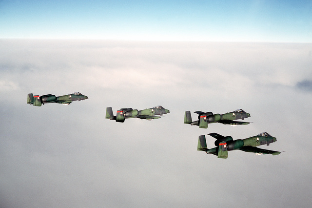 A-10 Thunderbolt II aircraft from the 353rd Tactical Fighter Squadron, Myrtle Beach Air Force Base, South Carolina, in flight over the Alaskan terrain and around Mt. McKinley. The A-10's are participating in Brim Frost '81