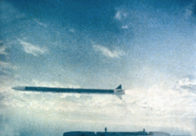 A close-up view of an advanced medium range air-to-air missile being fired by an F-15 Eagle aircraft