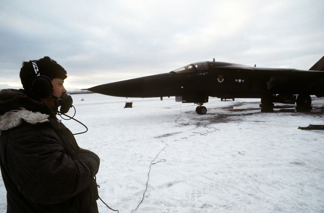 A flight line crewman talks to an FB-111A pilot before the aircraft is launched. The 391st Tactical Fighter Squadron aircraft, used as an aggressor, is participating in exercise Brim Frost '81