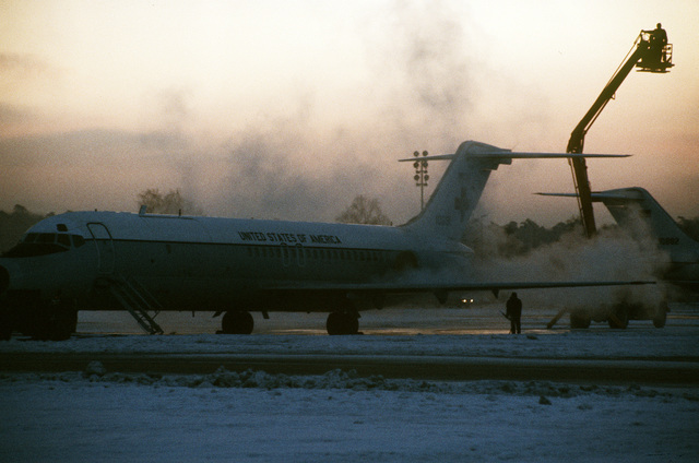 A left front view of two parked C-9 Nightingale aircraft prior to their departure for Algeria. The aircraft will pick up the 52 freed hostages released from Iran and return them to the base