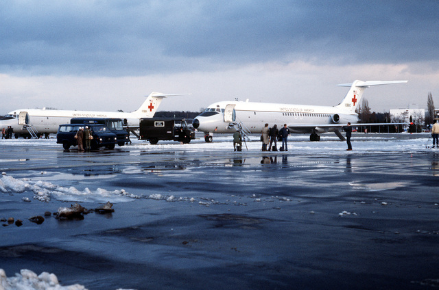 A left front view of two parked C-9 Nightingale aircraft prior to their departure for Algeria. The aircraft will pick up the 52 freed hostages released from Iran and return then to the base
