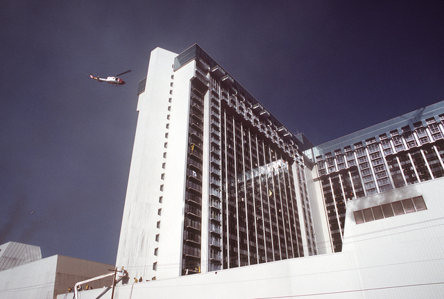 A UN-1N Iroquois helicopter is involved in a mission to rescue guests from the burning MGM Grand Hotel. The helicopter is assigned to the 57th Fighter Weapons Wing