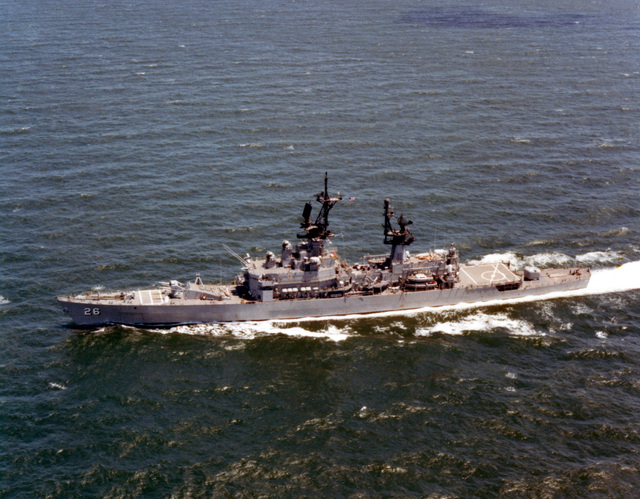 An aerial port beam view of the guided missile cruiser USS BELKNAP (CG 26) underway