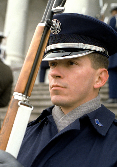 An Air Force member of the All-Service Honor Guard stands with his rifle at the position of port arms during pre-inauguration day activities