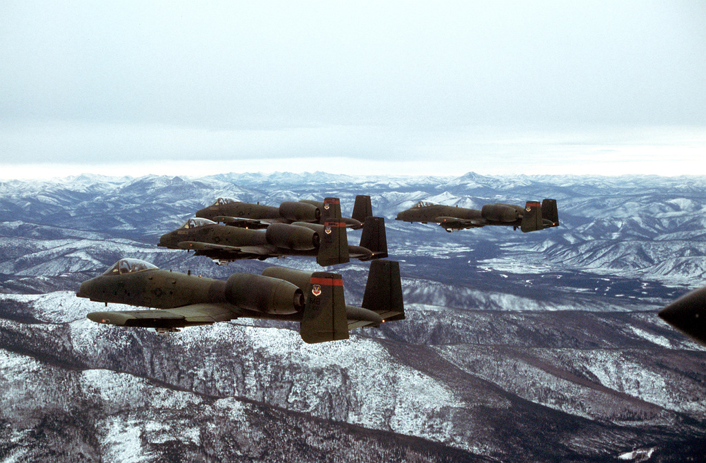 AN air-to-air left side view of a four-ship formation of A-10 aircraft during exercise Brim Frost '81. The aircraft are from the 353rd Tactical Fighter Squadron, 354th Tactical Fighter Wing