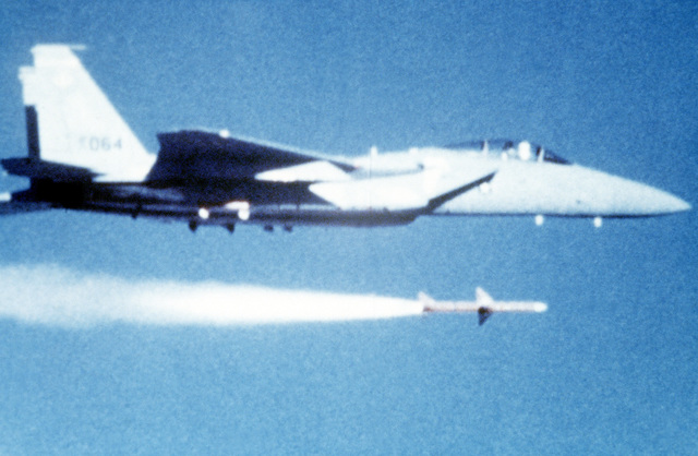 AN air-to-air view of an F-15 Eagle aircraft firing an AIM-7 Sparrow missile